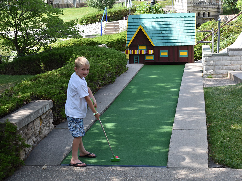 Miniature Golf Player at Cherry Hill Water Park, Family Fun Center & Camping Resort